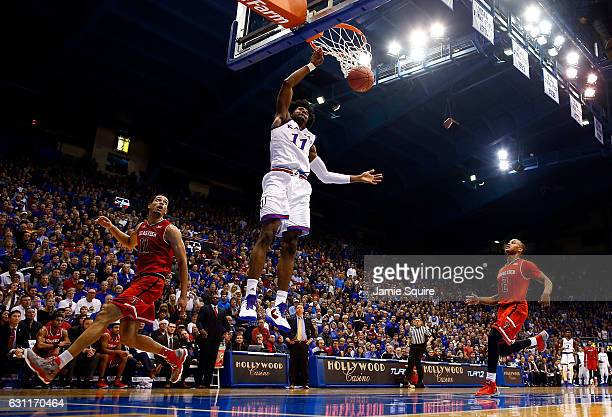 Josh Jackson of the Kansas Jayhawks dunks on a fast break during the game against the Texas Tech Red Raiders at Allen Fieldhouse on January 7 2017 in...