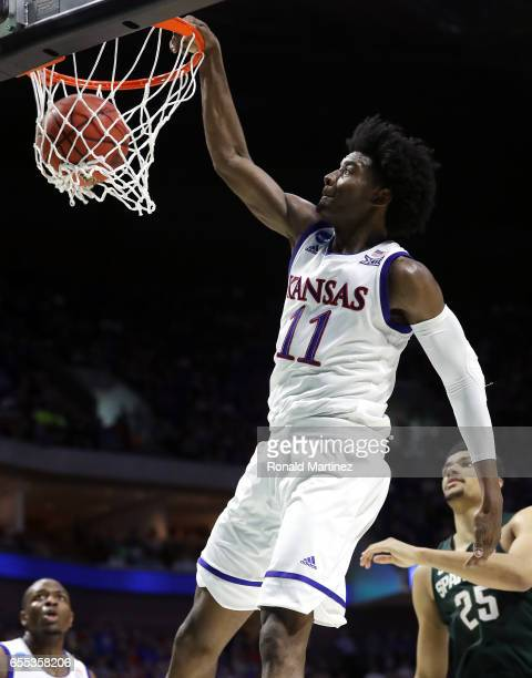 Josh Jackson of the Kansas Jayhawks dunks the ball against the Michigan State Spartans during the second round of the 2017 NCAA Men's Basketball...