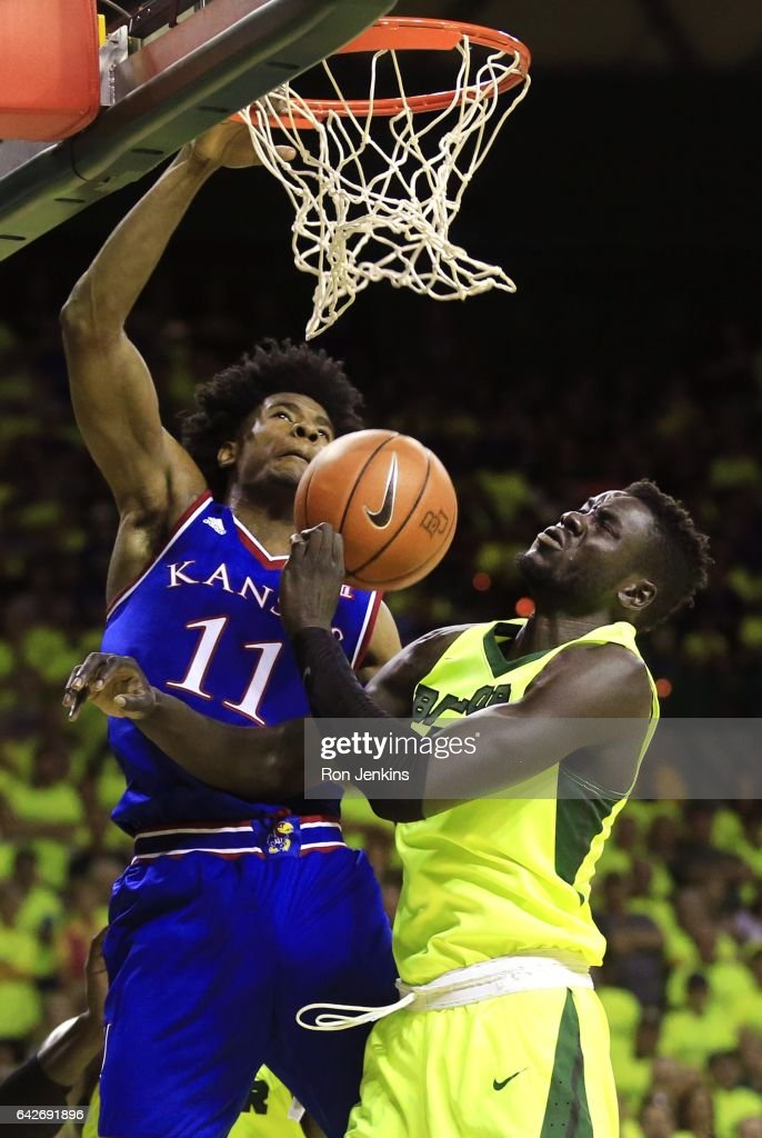 Josh Jackson #11 of the Kansas Jayhawks dunks to score as Jo Lual-Acuil Jr. #0 of the Baylor Bears defends in the second half at the Ferrell Center on February 18, 2017 in Waco, Texas. Kansas won 67-65.