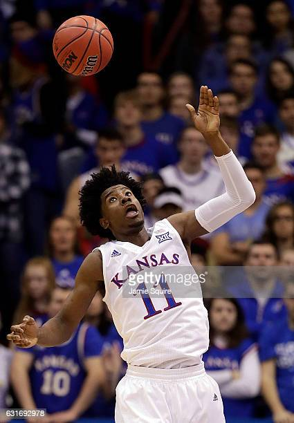 Josh Jackson of the Kansas Jayhawks grabs a rebound during the game against the Oklahoma State Cowboys at Allen Fieldhouse on January 14 2017 in...