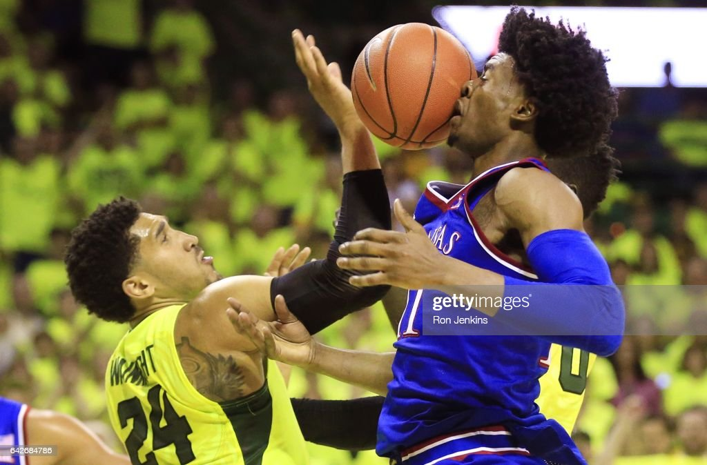 Josh Jackson #11 of the Kansas Jayhawks has the ball deflect off his face as Ishmail Wainright #24 of the Baylor Bears defends in the second half at the Ferrell Center on February 18, 2017 in Waco, Texas. Kansas won 67-65.