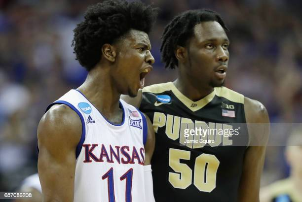 Josh Jackson of the Kansas Jayhawks reacts in the second half as Caleb Swanigan of the Purdue Boilermakers looks on during the 2017 NCAA Men's...