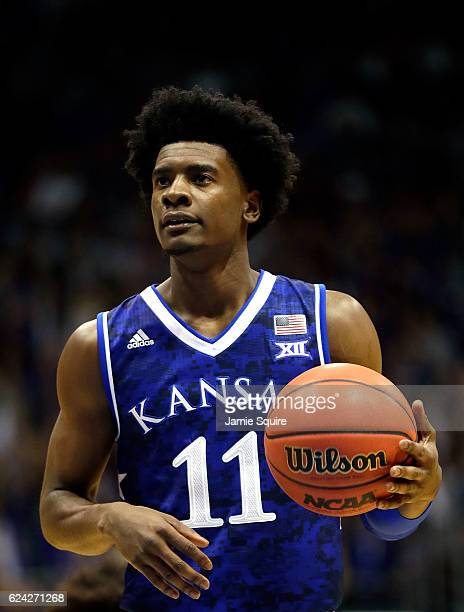 Josh Jackson of the Kansas Jayhawks shoots a free throw during the game against the Siena Saints at Allen Fieldhouse on November 18 2016 in Lawrence...