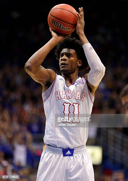 Josh Jackson of the Kansas Jayhawks shoots a free throw during the game against the UMKC Kangaroos at Allen Fieldhouse on December 6 2016 in Lawrence...