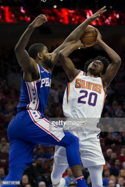 Josh Jackson of the Phoenix Suns attempts a shot against Amir Johnson of the Philadelphia 76ers in the first quarter at the Wells Fargo Center on...