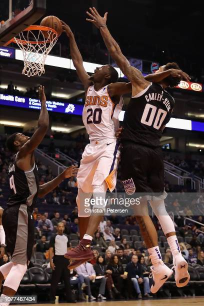 Josh Jackson of the Phoenix Suns attempts a slamdunk against Willie CauleyStein of the Sacramento Kings during the second half of the NBA game at...