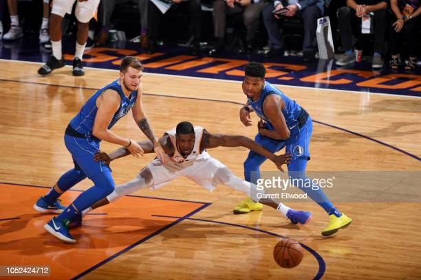 Josh Jackson of the Phoenix Suns defends against Luka Doncic and Dennis Smith Jr #1 of the Dallas Mavericks on October 17 2018 at Talking Stick...