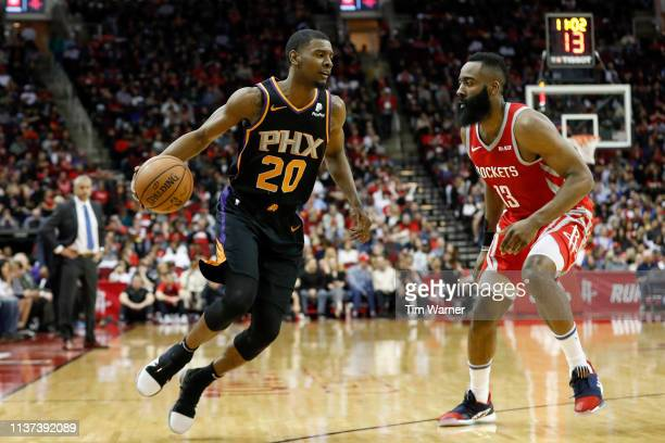 Josh Jackson of the Phoenix Suns drives to the basket defended by James Harden of the Houston Rockets in the second half at Toyota Center on March 15...