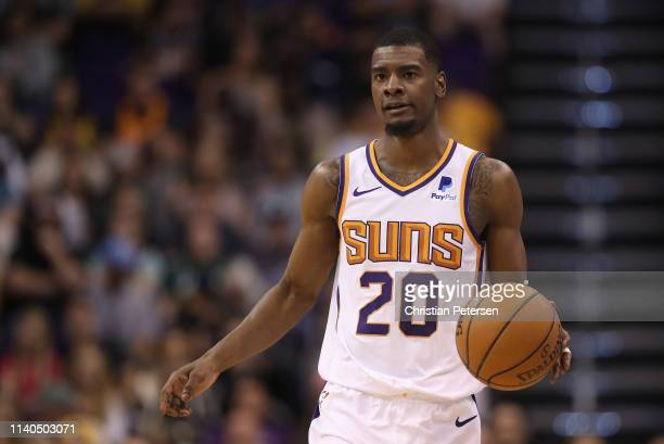 Josh Jackson of the Phoenix Suns handles the ball during the first half of the NBA game against the Utah Jazz at Talking Stick Resort Arena on April...