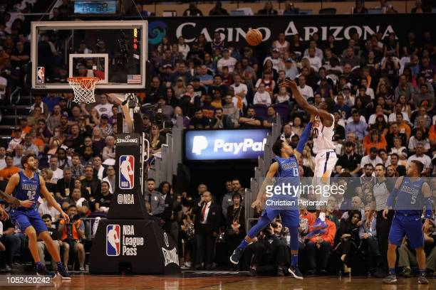 Josh Jackson of the Phoenix Suns puts up a shot over Jalen Brunson of the Dallas Mavericks during the first half of the NBA game at Talking Stick...