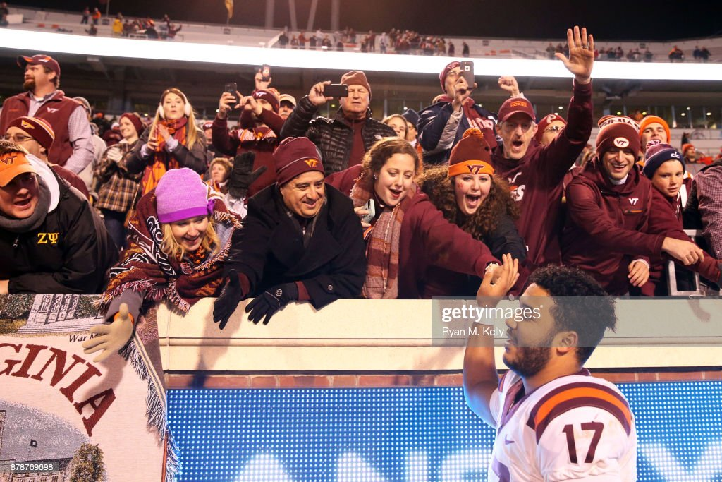 Josh Jackson #17 of the Virginia Tech Hokies celebrates with fans after a game against the Virginia Cavaliers at Scott Stadium on November 24, 2017 in Charlottesville, Virginia. Virginia Tech defeated Virginia 10-0.