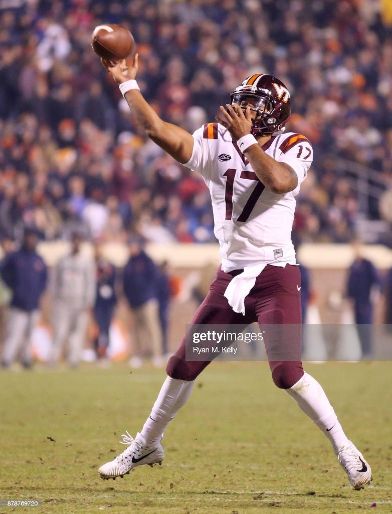 Josh Jackson #17 of the Virginia Tech Hokies throws a touchdown pass in the third quarter during a game against the Virginia Cavaliers at Scott Stadium on November 24, 2017 in Charlottesville, Virginia. Virginia Tech defeated Virginia 10-0.