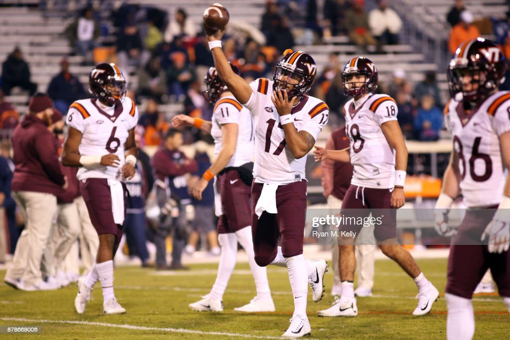Josh Jackson #17 of the Virginia Tech Hokies warms up before the start of a game against the Virginia Cavaliers at Scott Stadium on November 24, 2017 in Charlottesville, Virginia.
