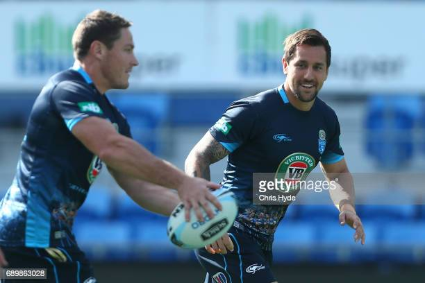Josh Jackson passes to Mitchell Pearce during the New South Wales Blues State of Origin captain's run at Cbus Super Stadium on May 30 2017 in Gold...