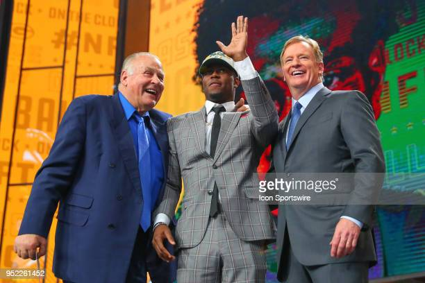 Josh Jackson poses for photos with NFL Commissioner Roger Goodell and NFL Hall of Famer Jerry Kramer after being chosen by the Green Bay Packers with...