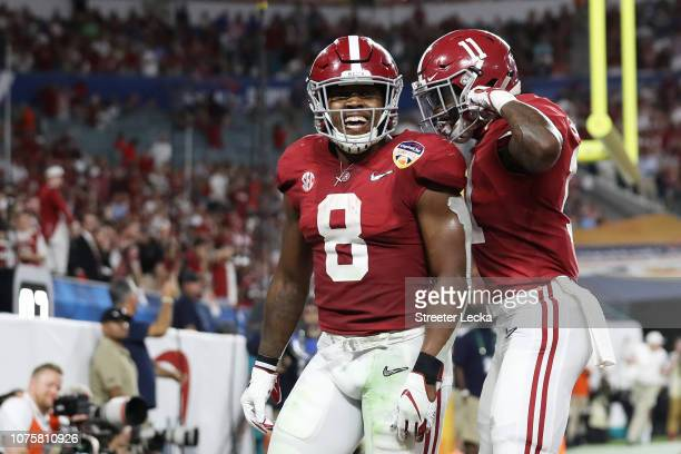 Josh Jacobs and Henry Ruggs III of the Alabama Crimson Tide reacts after scoring a touchdwon in the second quarter during the College Football...