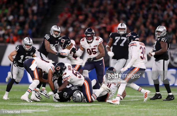 Josh Jacobs of Oakland Raiders is tackled by Roquan Smith of Chicago Bears after rushing the ball during the game between Chicago Bears and Oakland...