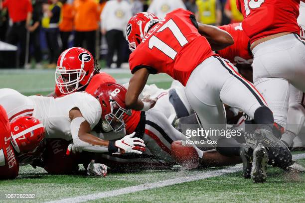 Josh Jacobs of the Alabama Crimson Tide fumbles and recovers the ball for a touchdown in the second quarter against the Georgia Bulldogs during the...