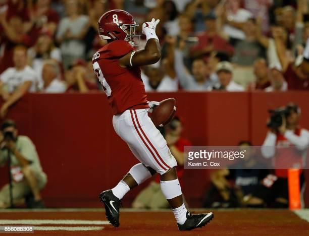 Josh Jacobs of the Alabama Crimson Tide reacts after scoring against Victor Evans of the Mississippi Rebels at BryantDenny Stadium on September 30...