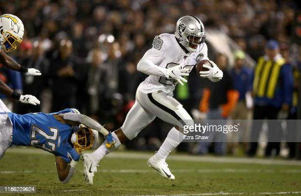 Josh Jacobs of the Oakland Raiders breaks free from Rayshawn Jenkins of the Los Angeles Chargers to run the ball in for the winning touchdown in the...
