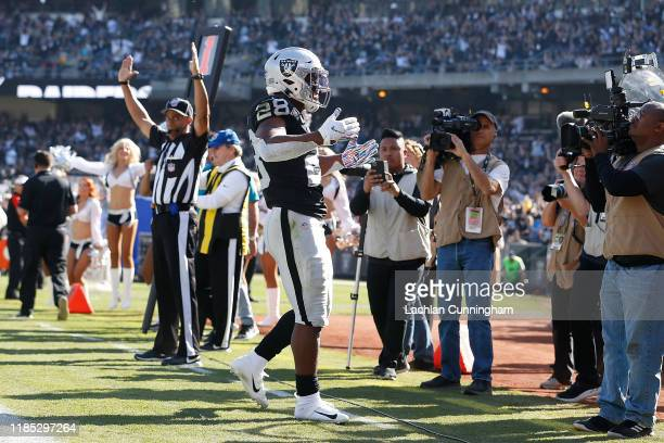 Josh Jacobs of the Oakland Raiders celebrates after running the ball in for a 2-yard touchdown in the first quarter against the Detroit Lions at...