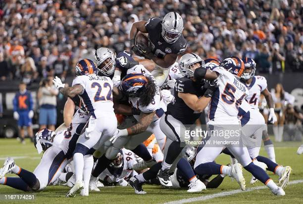 Josh Jacobs of the Oakland Raiders dives over the top for a twoyard touchdown run against the Denver Broncos during the second quarter of an NFL...