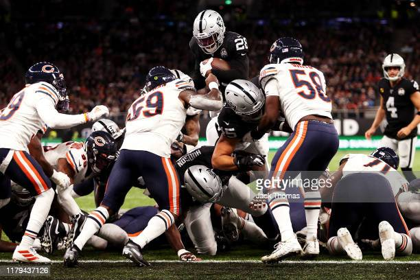 Josh Jacobs of the Oakland Raiders rushes for his team's third touchdown during the match between the Chicago Bears and Oakland Raiders at Tottenham...