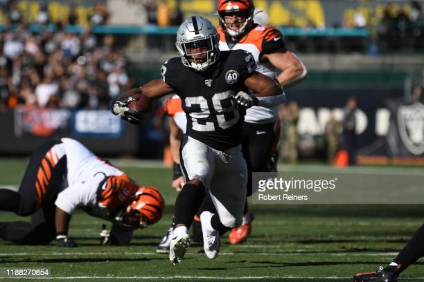 Josh Jacobs of the Oakland Raiders rushes with the ball against the Cincinnati Bengals during their NFL game at RingCentral Coliseum on November 17...