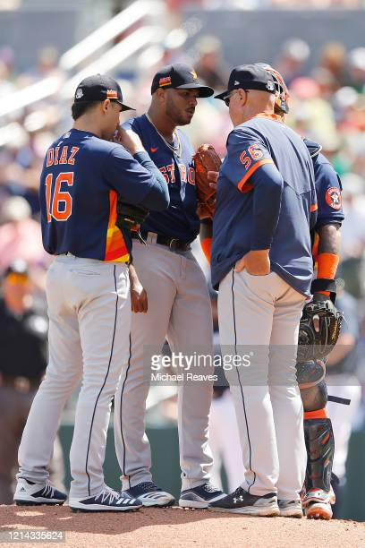 Josh James of the Houston Astros talks with pitching coach Brent Strom Martin Maldonado and Aledmys Diaz against the Atlanta Braves during the first...