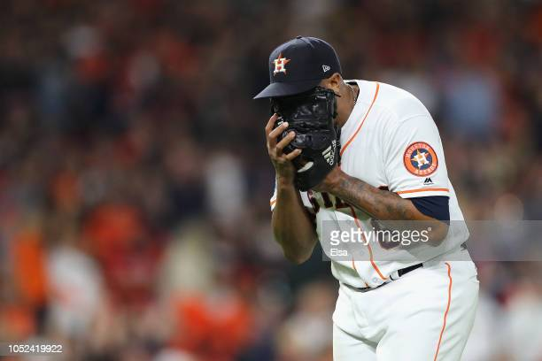 Josh James of the Houston Astros yells into his glove in the sixth inning against the Boston Red Sox during Game Four of the American League...