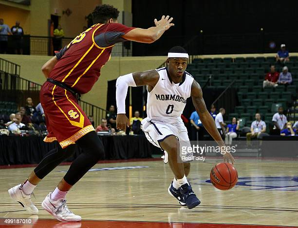 Josh James of the Monmouth Hawks drives to the basket as Bennie Boatwright of the USC Trojans defends during the game at HP Field House on November...