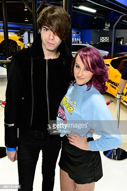 Josh Jaramillo of Exist Elsewhere and recording artist Camryn attend the Grand Opening of West Coast Customs Burbank Headquarters on December 7 2014...