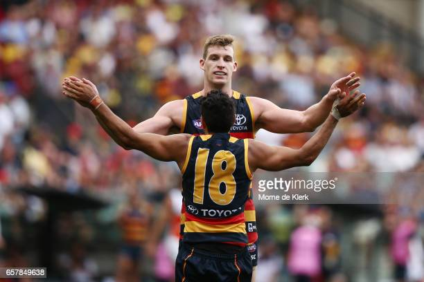 Josh Jenkins and Eddie Betts of the Crows celebrate a goal by Betts during the round one AFL match between the Adelaide Crows and the GWS Giants at...