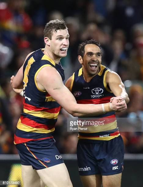 Josh Jenkins and Eddie Betts of the Crows celebrates a goal during the round 16 AFL match between the Adelaide Crows and the Western Bulldogs at...