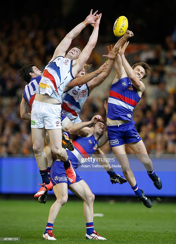 Josh Jenkins (left) and Rory Sloane of the Crows compete for the ball with Easton Wood (left), Matthew Boyd (centre) and Joel Hamling of the Bulldogs during the 2015 AFL Second Elimination Final match between the Western Bulldogs and the Adelaide Crows at the Melbourne Cricket Ground, Melbourne, Australia on September 12, 2015.