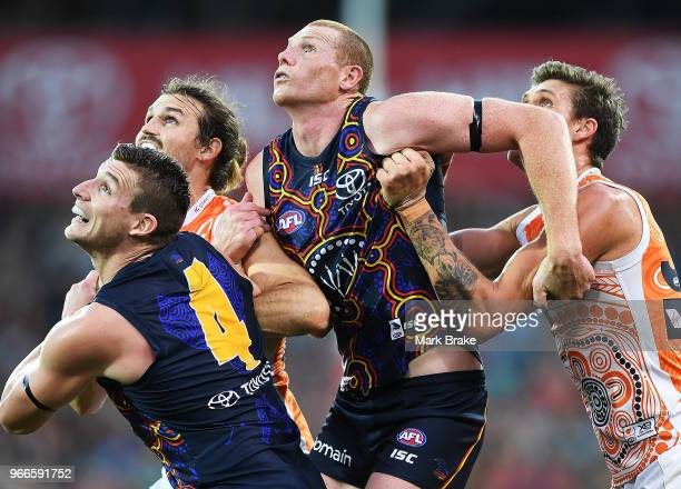 Josh Jenkins and Sam Jacobs of the Adelaide Crows competes and Rory Lobb and Phil Davis of the Giants with during the round 11 AFL match between the...