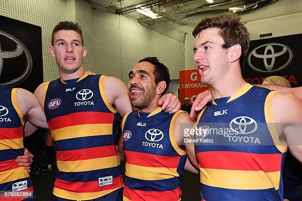 Josh Jenkins Eddie Betts and Ricky Henderson of the Crows sing the club song after the round 17 AFL match between the Adelaide Crows and the...