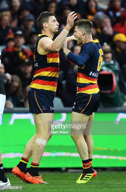 Josh Jenkins of the Adelaide Crows celebrates a goal with Bryce Gibbs of the Adelaide Crows during the round 20 AFL match between the Adelaide Crows...