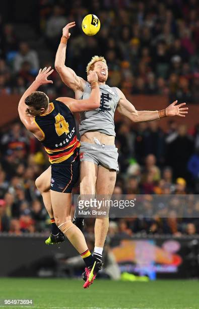 Josh Jenkins of the Adelaide Crows competes for the ball against Andrew Phillips of the Blues during the round seven AFL match between the Adelaide...