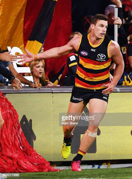 Josh Jenkins of the Adelaide Crows high fives a fan after kicking a goal during the round seven AFL match between the Adelaide Crows and the Carlton...