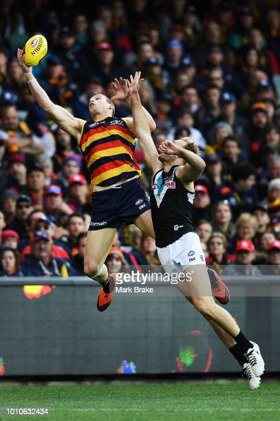 Josh Jenkins of the Adelaide Crows marks in front of Jack Hombsch of Port Adelaide during the round 20 AFL match between the Adelaide Crows and the...
