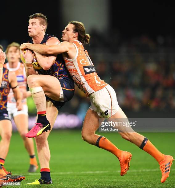 Josh Jenkins of the Adelaide Crows marks in front of Phil Davis of the Giants during the round 11 AFL match between the Adelaide Crows and the...