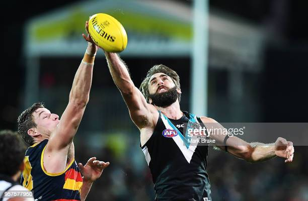 Josh Jenkins of the Adelaide Crows rucks against Justin Westhoff of Port Adelaide during the round eight AFL match between the Port Adelaide Power...
