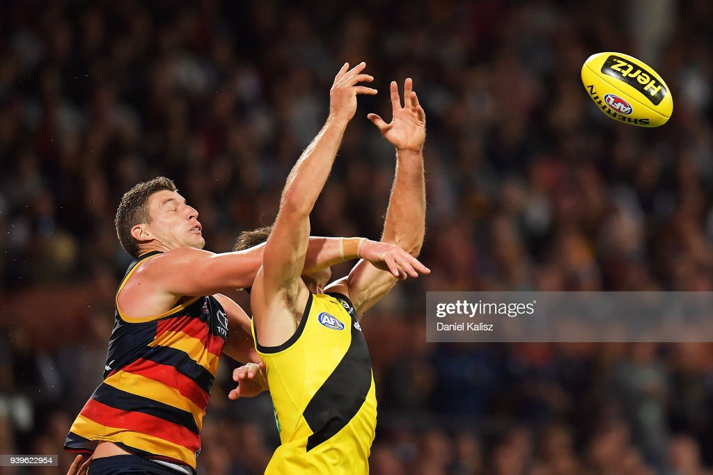 Josh Jenkins of the Crows and Alex Rance of the Tigers competes for the ball during the round two AFL match between the Adelaide Crows and the Richmond Tigers at Adelaide Oval on March 29, 2018 in Adelaide, Australia.