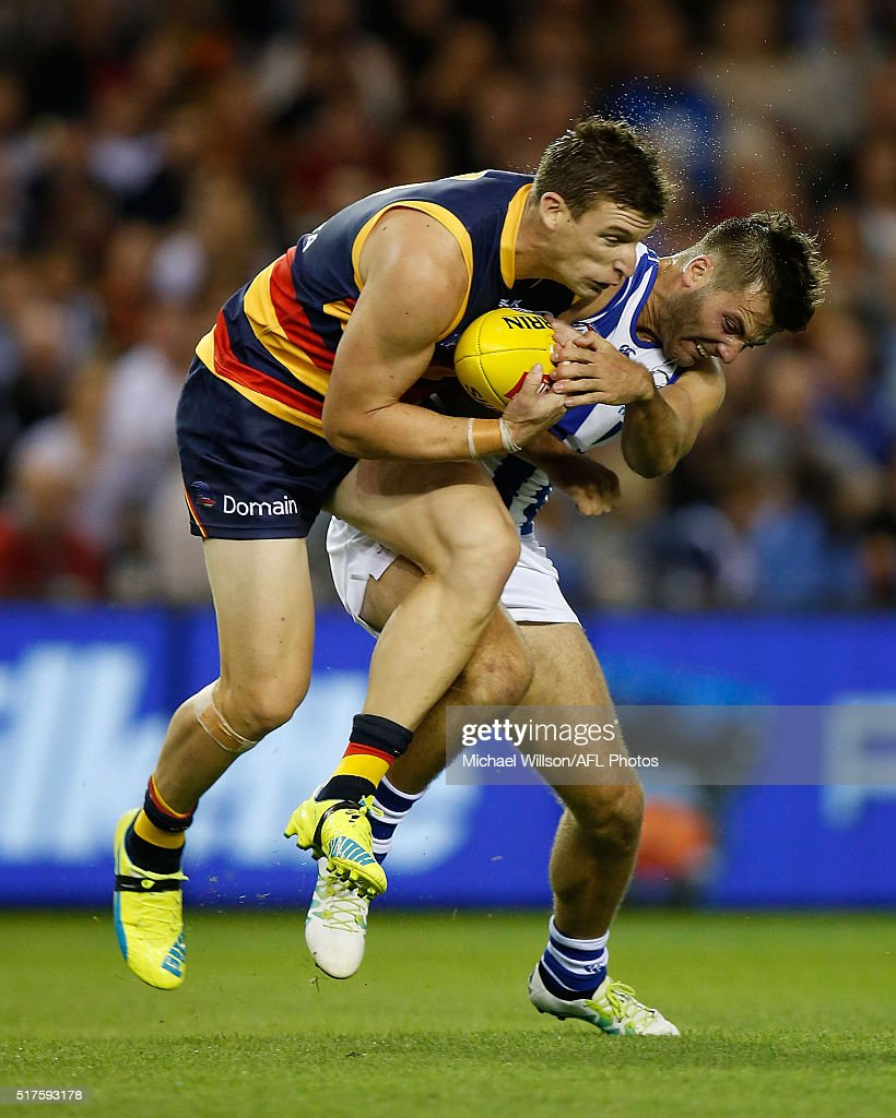 Josh Jenkins of the Crows and Luke McDonald of the Kangaroos collide during the 2016 AFL Round 01 match between the North Melbourne Kangaroos and the Adelaide Crows at Etihad Stadium, Melbourne on March 26, 2016.