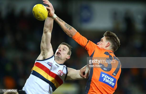 Josh Jenkins of the Crows and Rory Lobb of the Giants contest possession during the round 21 AFL match between the Greater Western Giants and the...
