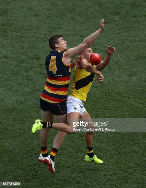 Josh Jenkins of the Crows and Shaun Grigg of the Tigers compete for the ball during the 2017 AFL Grand Final match between the Adelaide Crows and the...