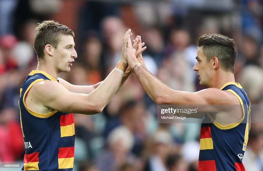 Josh Jenkins of the Crows (L) and Taylor Walker celebrates a goal during the round one AFL match between the Adelaide Crows and the North Melbourne Kangaroos at Adelaide Oval on April 5, 2015 in Adelaide, Australia.