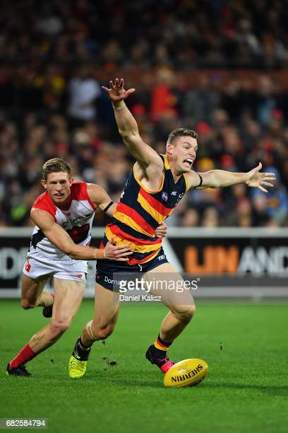 Josh Jenkins of the Crows appeals for a free kick as he is tackled by Sam Frost of the Demons during the round eight AFL match between the Adelaide...
