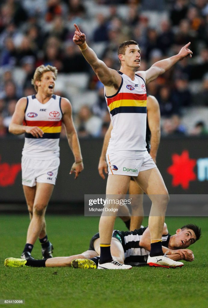 Josh Jenkins of the Crows celebrates a goal above Brayden Maynard of the Magpies during the round 19 AFL match between the Collingwood Magpies and the Adelaide Crows at Melbourne Cricket Ground on July 30, 2017 in Melbourne, Australia.